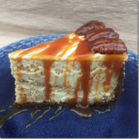 Swirled Pumpkin Cheesecake with Candied Pecans and Salted Caramel